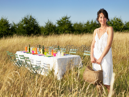 woman standing next to a table