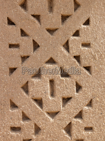 pattern designed into the mud brick