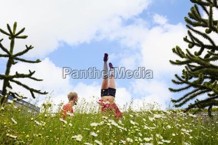 woman doing handstand in garden