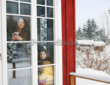 two women viewing snow scene