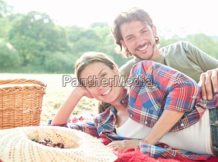 couple lying on rug smiling