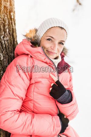 portrait of woman wearing pink ski