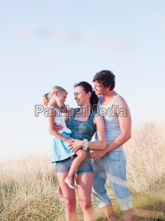 family together at the beach