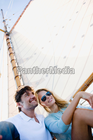 couple on a sailing boat smiling