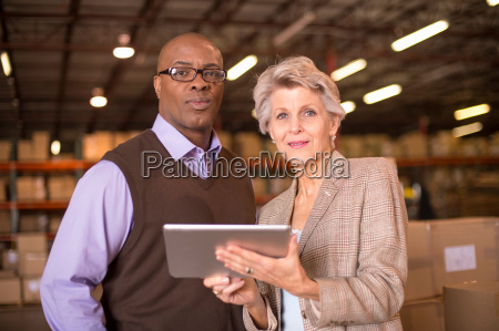 warehouse managers using digital tablet
