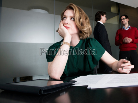 woman in office deep in thought