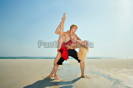 couple dancing on a beach