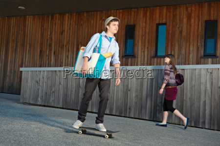 young man on skateboard with shopping
