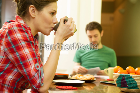 young couple at breakfast woman drinking