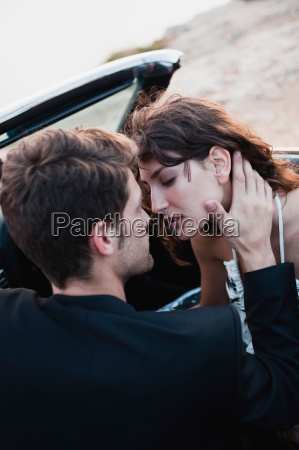 couple, in, car, front, seat, kissing - 19443298
