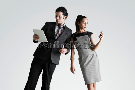 man using digital tablet woman on