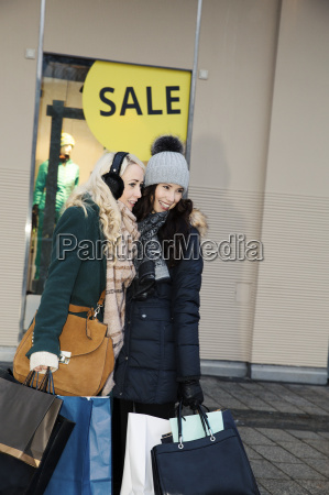 two mid adult women with shopping