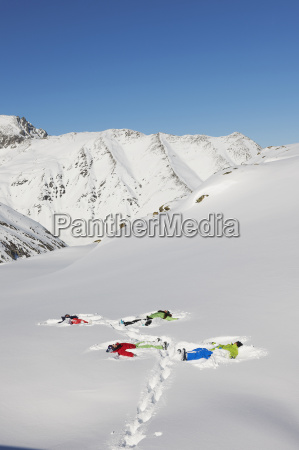 friends making snow angels kuhtai austria