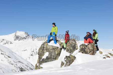 friends on rocks in snow kuhtai