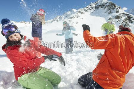 friends having snowball fight kuhtai austria