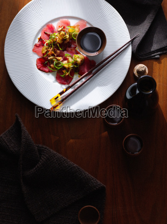 plate of steak carpaccio with sauce