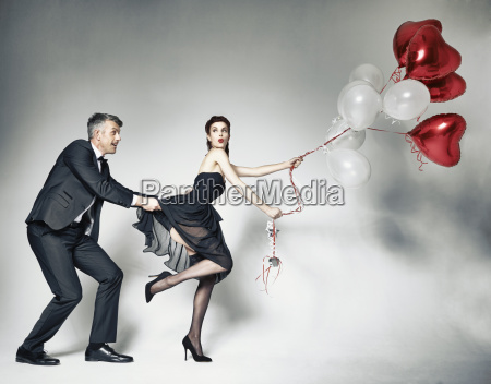 man pulling dress of woman with