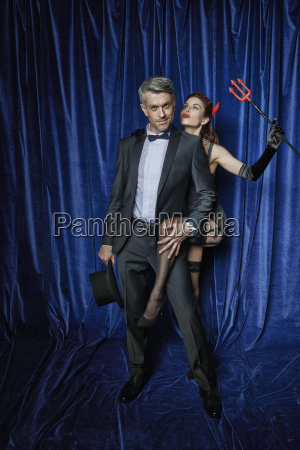 male entertainer with burlesque dancer holding