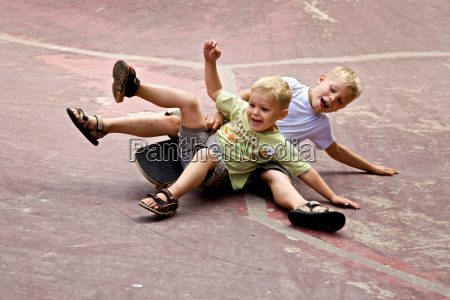 two children playing on the ground