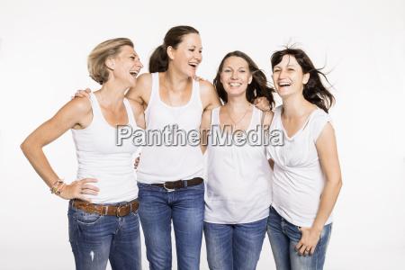 studio portrait of four happy mid