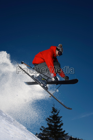 skier jumping into the air