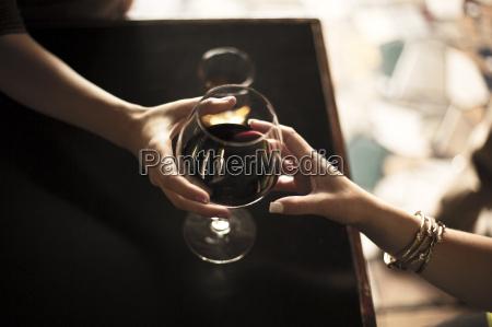close up of bartender serving glass