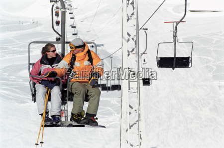 couple sitting on chair lift