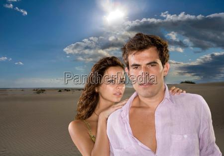 young couple portrait beach