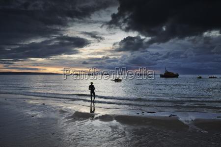 swimmer on coastline tenby wales uk