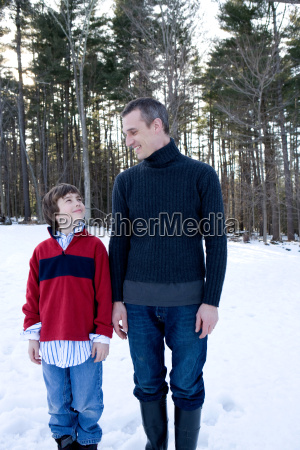 father and son in forest in