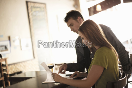 business, partners, looking, at, paperwork, in - 19450252