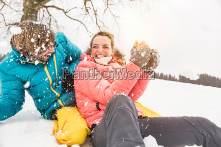 couple play fighting in snow