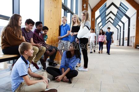 group of teenage schoolchildren sitting