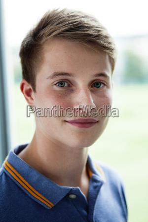 close up portrait of teenage schoolboy