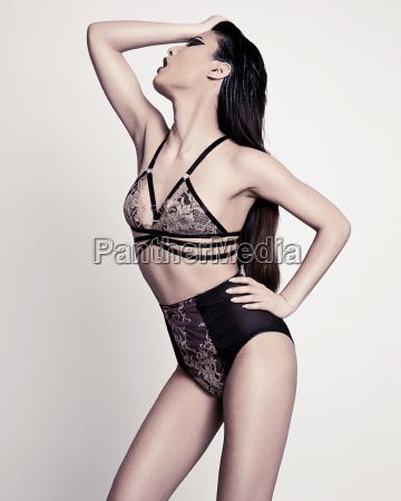 model wearing black strap lingerie
