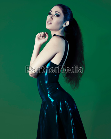 young woman wearing black plastic dress