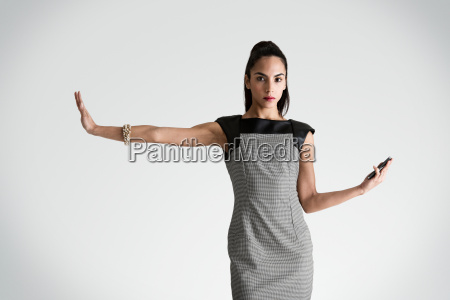 woman with cell phone holding arm