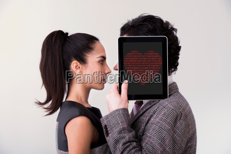 man holding digital tablet with heart