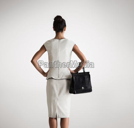 woman holding handbag rear view