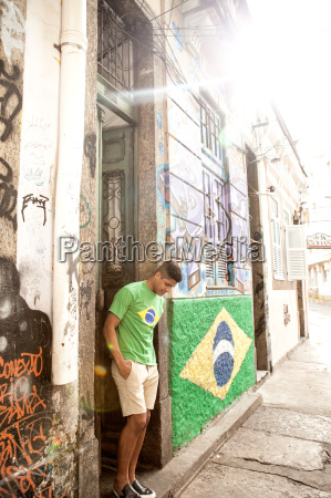 young man wearing brazil top standing