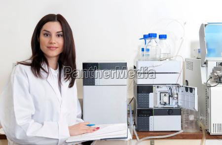 laboratory scientist using mass spectrometer spectrometry