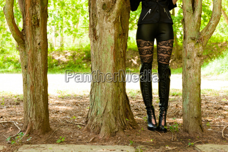 young woman in fetish wear standing