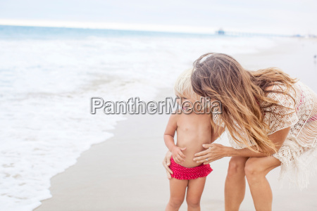 mother encouraging child to go into