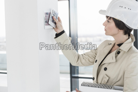 female architect choosing wall colour samples