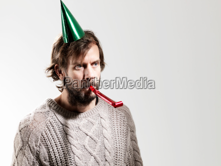mid adult man with party blower