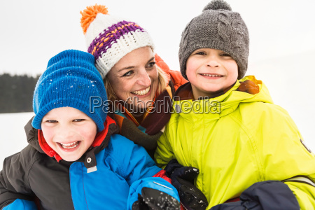 mother with two boys wearing knit