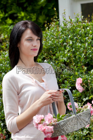 woman gathering flowers outdoors