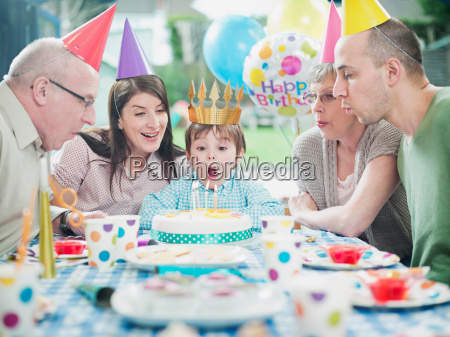 boy with family at birthday party