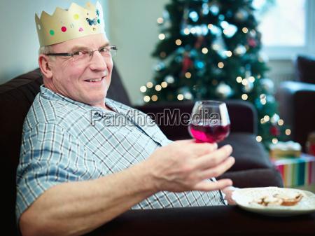 senior man wearing christmas hat portrait