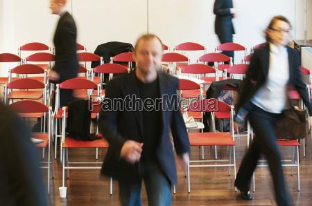 business people fleeing meeting